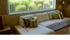 img salas tapicería telas materiales diseños con plantas de fondo